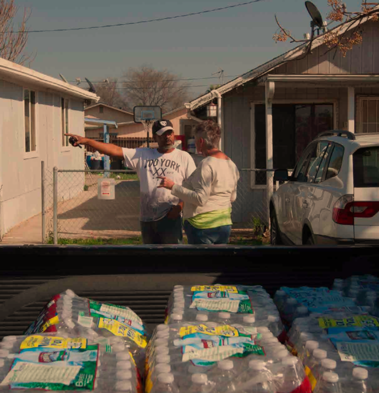 East Porterville residents distribute water during drought after local wells run dry.