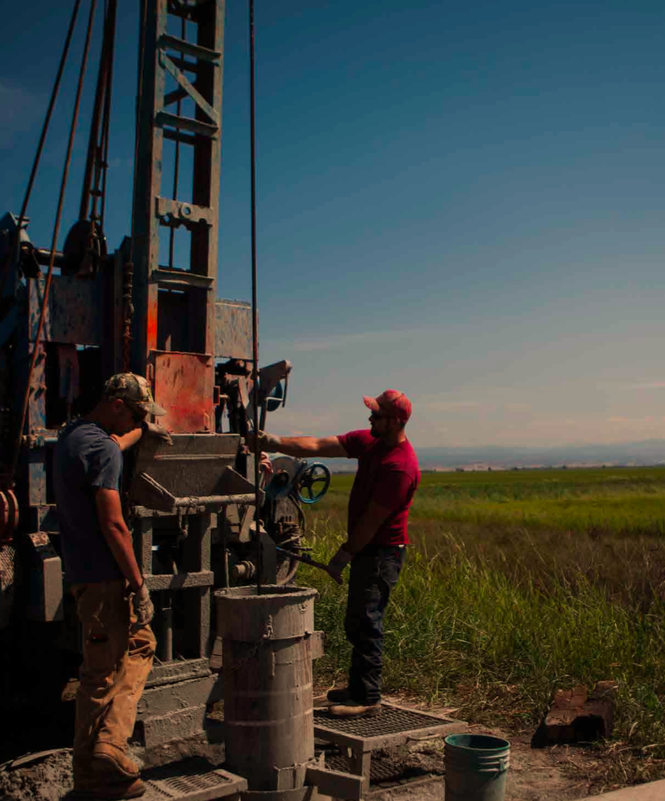 Residents drill groundwater well by rice field near Nelson, California.